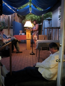 """Donald Revell waiting """"off-stage"""" while Claudia Keelan reads."""